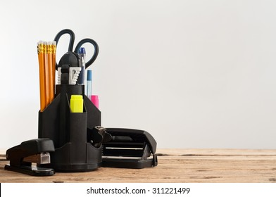 Stationery on wooden table on a gray background, closeup. Copy space. Free space for text