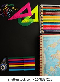 Stationery for school and office in bright colors on a black background, top view, there is space for text. Back to school. The concept of creative school.