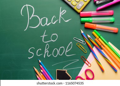 Stationery and words BACK TO SCHOOL written on chalkboard