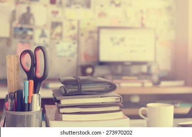Stationery,focused on pen in Blurred background workspace with vintage filter