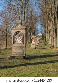 Stations of the Cross in avenue of beech tree near village Cvikov. Calvary with small chapels build in 1728 by Johann Franz Richter. Pilgrimage place Luzicke hory, Lusatian Mountains, spring, blue sky - Shutterstock ID 1724464333