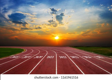 Statistical columns of chart shows the growth of the business from 2018-2025 Running Track on the morning sunset