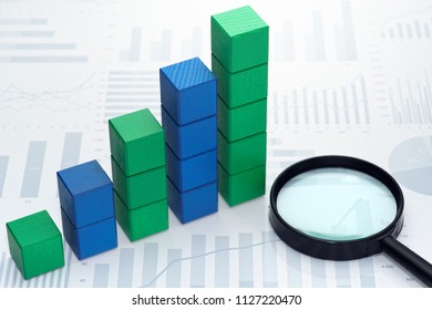 Statistical data analysis. Business data processing. Toy block steps on many charts and graphs background.