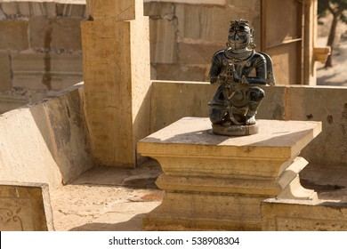 Statu of a Hindu deity Garuda in front of a temple dedicated to Vishnu, one of the main gods of Hinduism.  Fortress of Chittor (Chittorgarh) in Rajasthan, India. A UNESCO World Heritage Site.