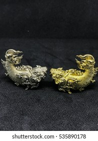 statuary fish gold and silver lucky