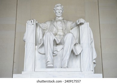 Statue of American president Abraham Lincoln seated in white marble at Lincoln Memorial Washington DC USA