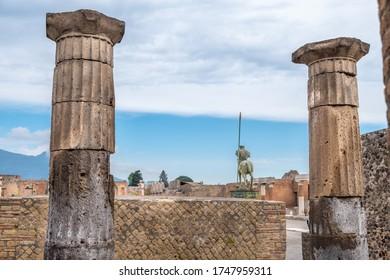 Statue in Ancient ruins of Pompei (Scavi di Pompei), Naples, Italy