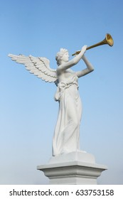 Statue of an angel blowing a trumpet