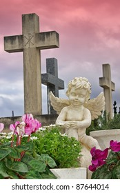 Statue of an angel boy located in a cemetery