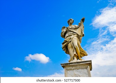 The statue of angel figure on the Aelian Bridgein  in Rome in a sunny day.