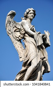 Statue of an Angel with the Garment and Dice. Sant'Angelo bridge, Rome, Italy