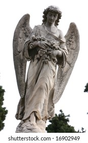 Statue of an angel in a grave yard 3/4