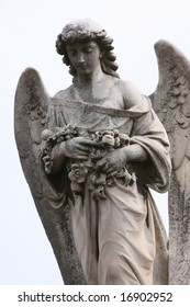 Statue of an angel in a grave yard 4/4