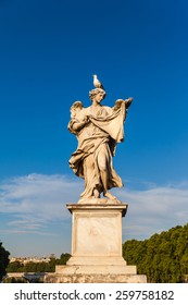 Statue of angel with on the bridge in front of Castel Sant'Angelo, Rome, Italy