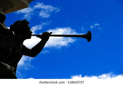 The statue of an angel playing a trumpet