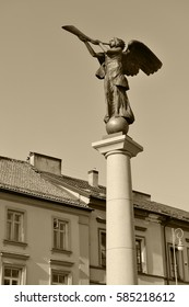 Statue of an angel at Uzupio in Vilnius, Lithuania, Sepia toned photo