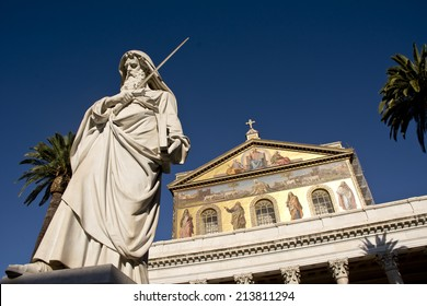 The Statue of the Apostle Paul standing in front of the Papal Basilica of Saint Paul Outside the Walls, Rome, Italy