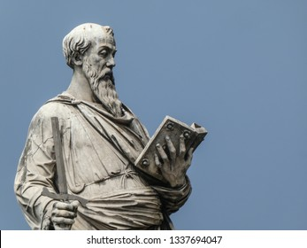 Statue of the apostle St. Paul holding a broken sword and a book with the pedestal inscription Borgo, on Ponte Sant'Angelo, Rome, Italy. The sculpture was by the Italian early Renaissance Paolo Romano