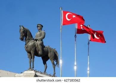 The statue of Ataturk and national flags of modern Turkey in Ulus - Ankara, Turkey