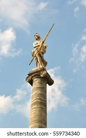 The statue is Athena, Ancient Greece' goddess, in the the blue sky  background. Kuskovo, Moscow, Sheremetev's manor