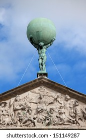 Statue of Atlas supporting the World and reliefs on pediment of the Royal Palace in Amsterdam, Netherlands.
