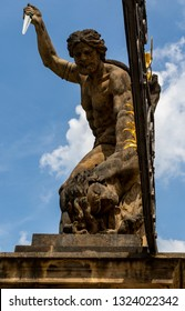 Statue of Battling Titan with a dagger at the main Gate of Hradcany Castle in Prague, Czech Republic, blue sky, sunny day