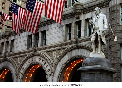 A statue of Benjamin Franklin stands outside of the Old Post Office Building in Washington, D.C.
