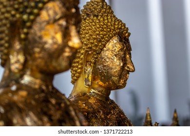 Statue of Bhudda covered with golden leaf at Wat Arun temple, Thailand
