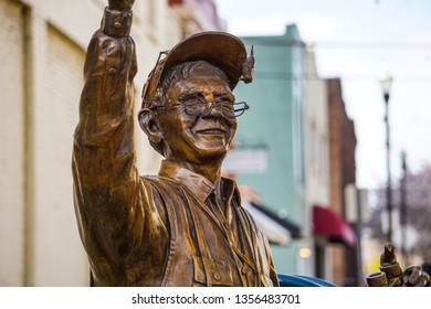 Statue of a bird watcher in downtown Kingsport, TN on April 1, 2019.