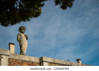 statue of a boy. the background