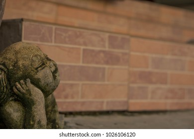 statue of a boy with a cork