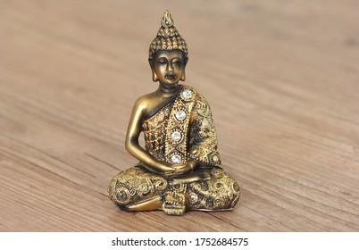 Statue of Buda in macro detail Golden