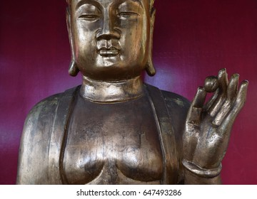 Statue of Buddha holding a lotus seed. Japanese Garden, Madeira. January 2017. for editorial use only