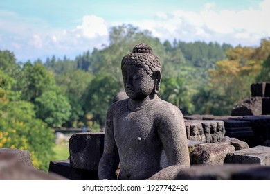 Statue of Buddha in the largest tample in the world, Candi Borobudur Indonesia.