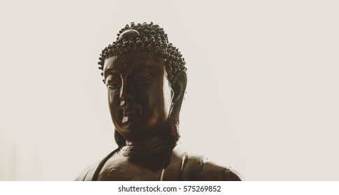 statue of Buddha in Nirvana. Symbols of Buddhism around the world. Unfocused & texture of the flare