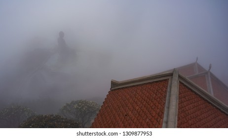 Statue of Buddha and roof of the temple in clouds on Fansipan Mountain, Sapa, Vietnam