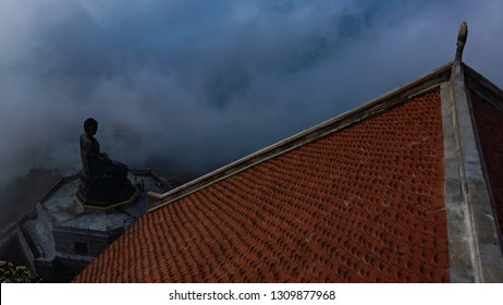 Statue of Buddha and roof of the temple on Fansipan Mountain, Sapa, Vietnam