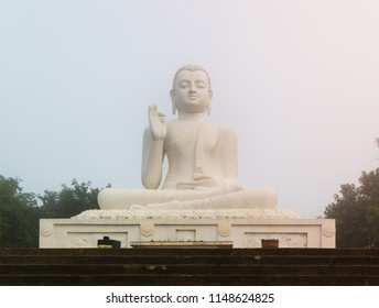 Statue of Buddha, sitting and praying, on an altar on the sacred buddhist site of Mihintale in Sri Lanka.