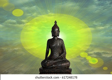 statue of buddha with sun and rays background