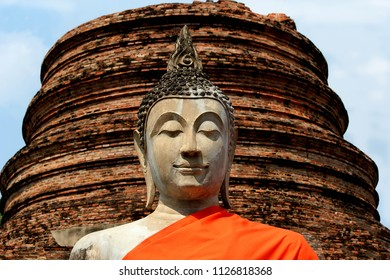 Statue of the Buddha's face is smiling.
