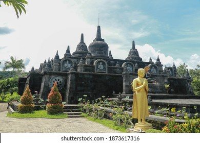 Statue of the Buddhist God Buddha in the Buddhist temple Brahma Vihara Arama with statues of the gods on Bali island, Indonesia. Bali Architecture, Ancient design. Travel concept