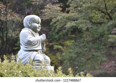 Statue of Buddhist monk in the outdoor garden of Waujeongsa Temple in Haegok-dong, Cheoin-gu, Yongin-si, Gyeonggi-do, South Korea.