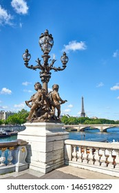 "Statue with Candelabra Lamp and Putti at ""Pont Alexandre III"" in Paris with Eiffel Tower in the background"