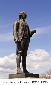 Statue of Captain Cook in Victoria Canada with blue sky and clouds in background