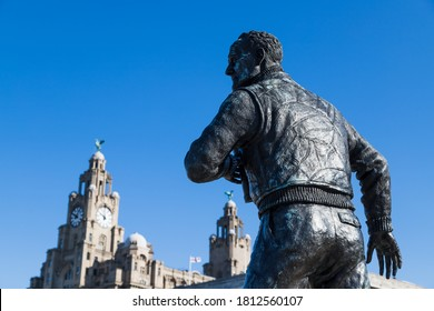 Statue of Captain FJ Walker seen in front of the three graces on the famous waterfront of Liverpool (England) captured in September 2020.