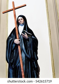 Statue of catholic nun holding a cross