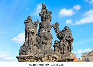 Statue at Charles Bridge in Prague, Czech Republic and blue sky