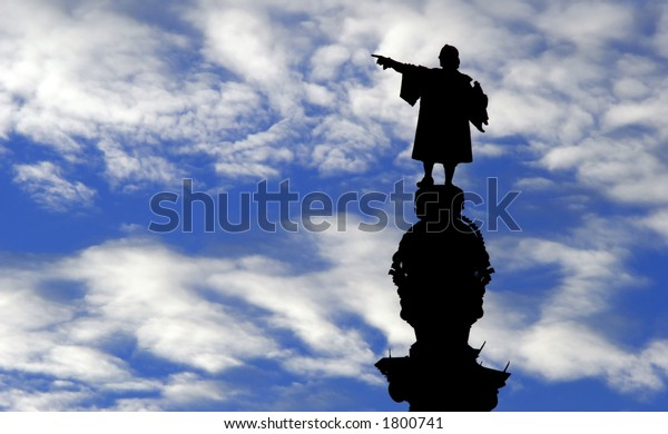 A Statue of Christopher Columbus against a blue sky.
