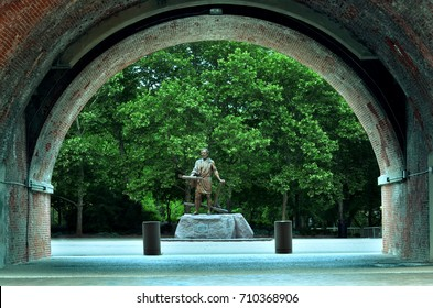 the statue of Cincinnatus stands noble under the archway along the Ohio river in Cincinnati