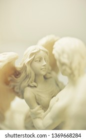 statue of a couple of angels embracing
